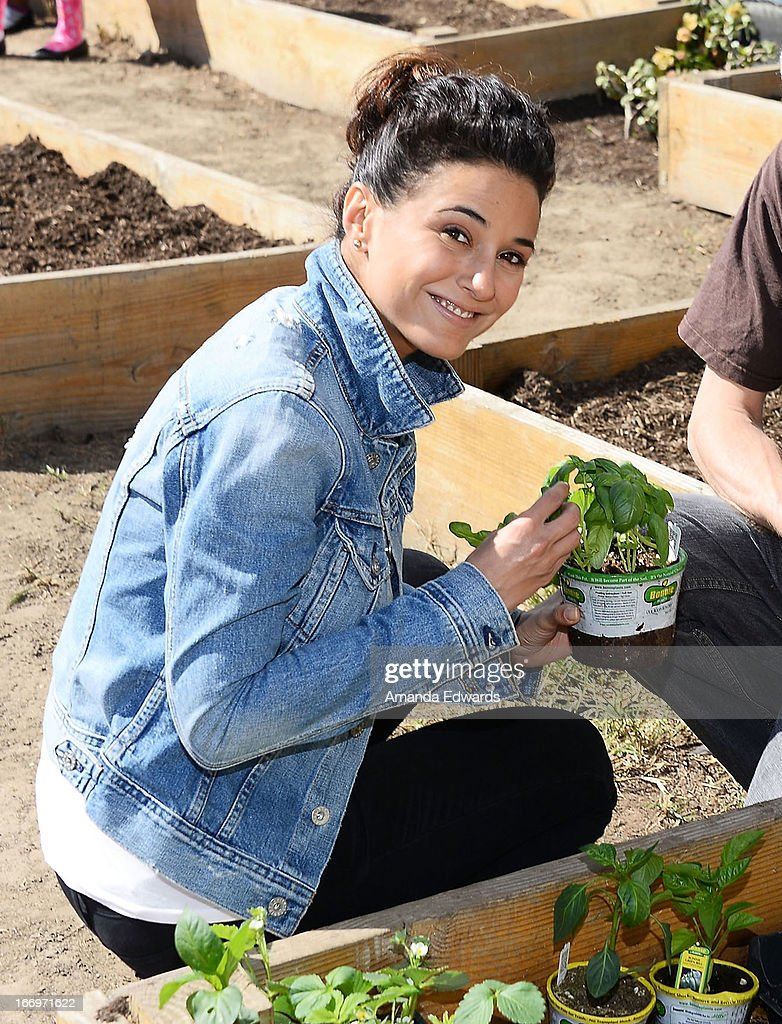 Actress <a gi-track='captionPersonalityLinkClicked' href=/galleries/search?phrase=Emmanuelle+Chriqui&family=editorial&specificpeople=541098 ng-click='$event.stopPropagation()'>Emmanuelle Chriqui</a> celebrates Earth Day with the Environmental Media Association at Cochran Middle School on April 18, 2013 in Los Angeles, California.