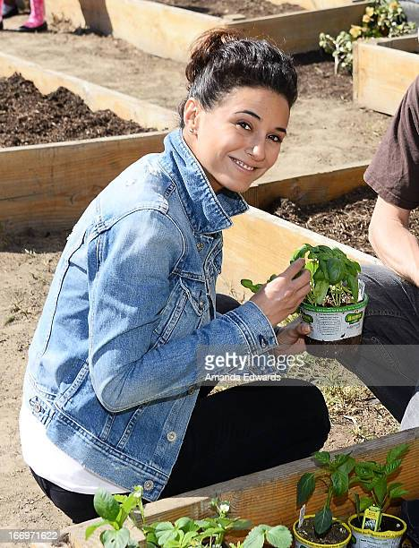 Actress Emmanuelle Chriqui celebrates Earth Day with the Environmental Media Association at Cochran Middle School on April 18 2013 in Los Angeles...