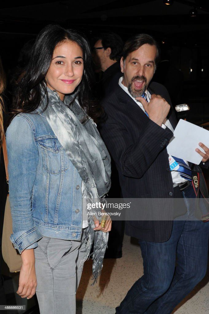 Actress Emmanuelle Chriqui gets photobombed by photographer Todd Williamson at the Los Angeles premiere of 'Fed Up' at Pacfic Design Center on May 8, 2014 in West Hollywood, California.