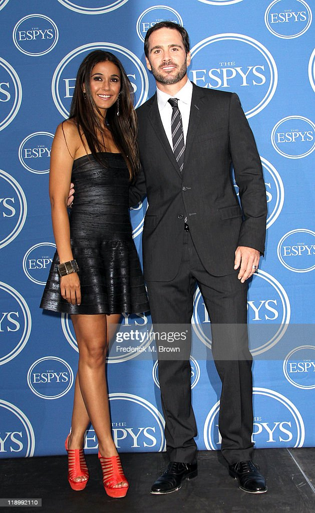 Actress Emmanuelle Chriqui poses in the press room with NASCAR driver Jimmie Johnson at The 2011 ESPY Awards at Nokia Theatre L.A. Live on July 13, 2011 in Los Angeles, California.