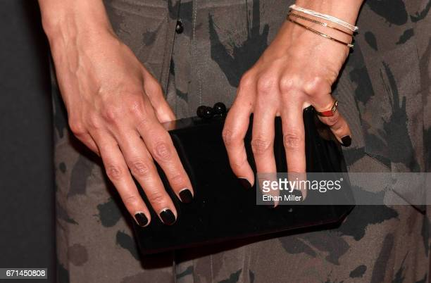 Actress Emmanuelle Chriqui purse detail attends the grand opening of 'Magic Mike Live Las Vegas' at the Hard Rock Hotel Casino on April 21 2017 in...
