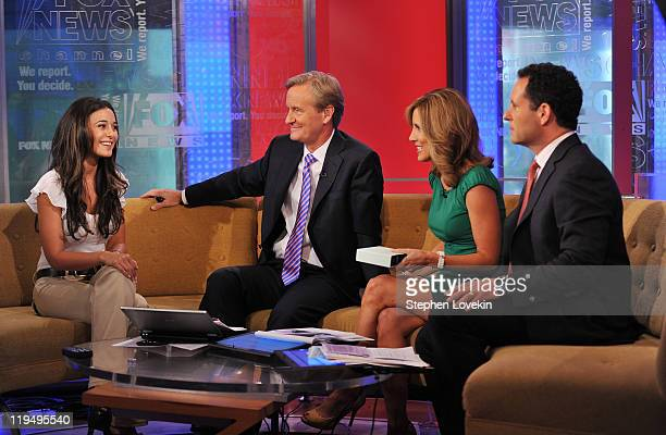 Actress Emmanuelle Chriqui talks with hosts Steve Doocy Alisyn Camerota and Brian Kilmeade on the set of 'FOX Friends' at FOX Studios on July 21 2011...