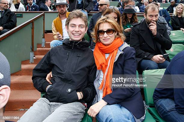 Actress Emmanuelle Devos and his son Raphael attend Day Eleven of the 2016 French Tennis Open at Roland Garros on June 1 2016 in Paris France