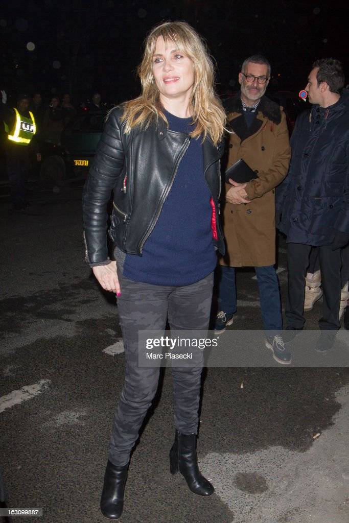 Actress Emmanuelle Seigner arrives to attend the 'Saint Laurent' Fall/Winter 2013 Ready-to-Wear show as part of Paris Fashion Week on March 4, 2013 in Paris, France.