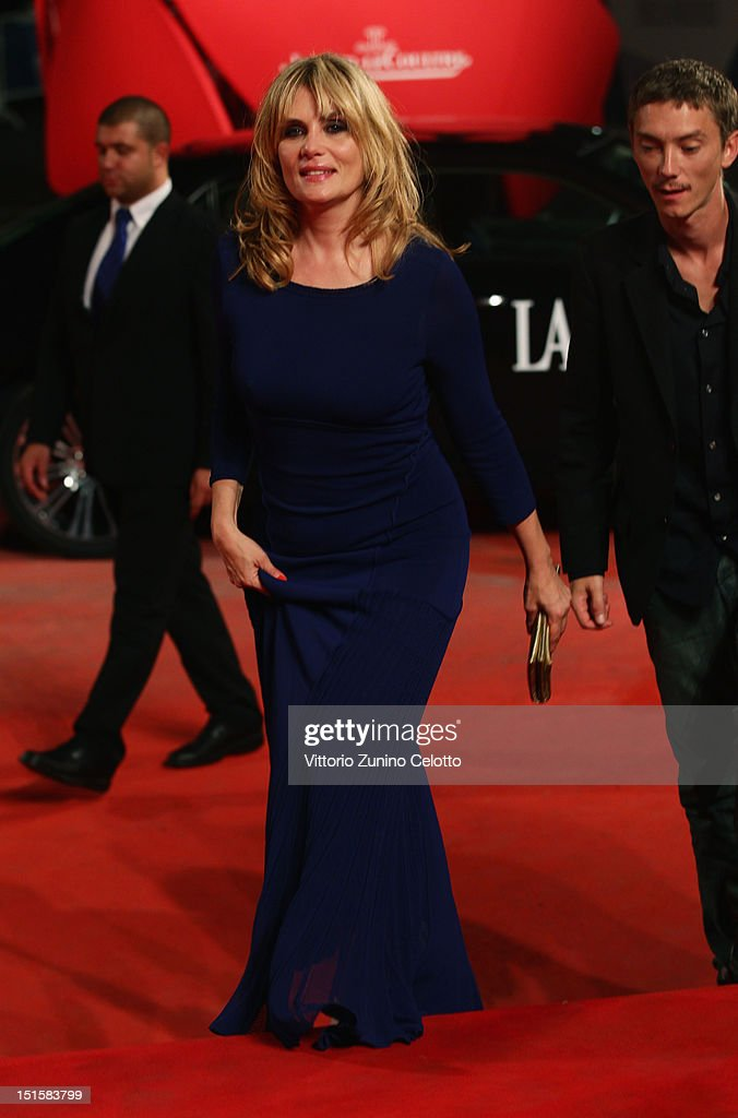 Actress <a gi-track='captionPersonalityLinkClicked' href=/galleries/search?phrase=Emmanuelle+Seigner&family=editorial&specificpeople=240590 ng-click='$event.stopPropagation()'>Emmanuelle Seigner</a> attends the 'L'Homme Qui Rit' Premiere during the 69th Venice Film Festival at the Palazzo del Cinema on September 8, 2012 in Venice, Italy.