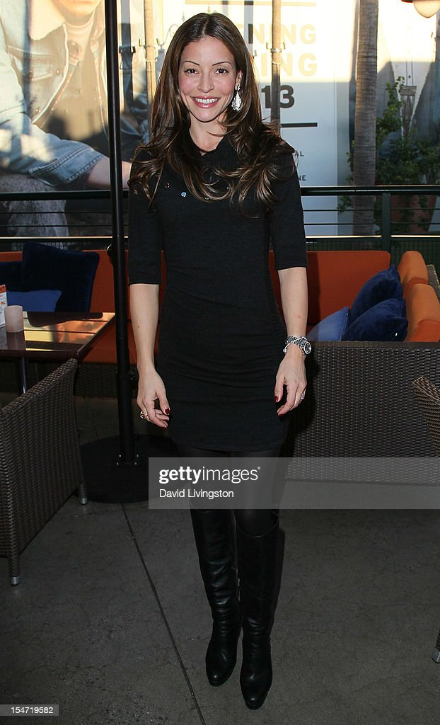Actress Emmanuelle Vaugier attends a reception to celebrate the release of Chuck Lorre's 'What Doesn't Kill Us Makes Us Bitter' at Mixology101 & Planet Dailies on October 24, 2012 in Los Angeles, California.