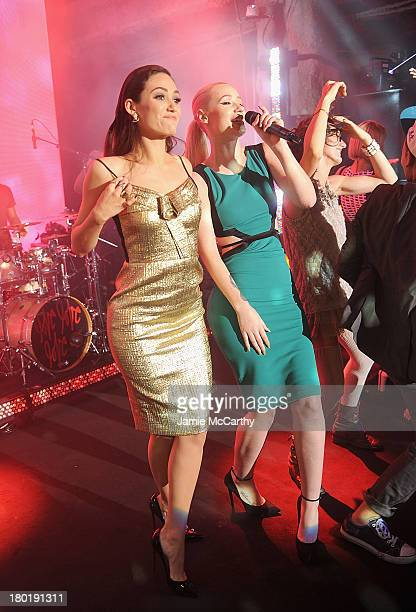 Actress Emmy Rossum and Iggy Azalea onstage at the #DKNY25 Birthday Bash on September 9 2013 in New York City