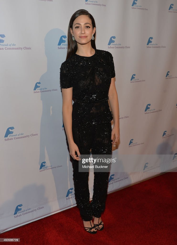 Actress <a gi-track='captionPersonalityLinkClicked' href=/galleries/search?phrase=Emmy+Rossum&family=editorial&specificpeople=202563 ng-click='$event.stopPropagation()'>Emmy Rossum</a> arrives at the 37th Annual Saban Community Clinic Gala at The Beverly Hilton Hotel on November 25, 2013 in Beverly Hills, California.