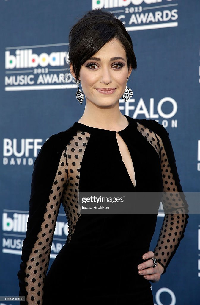 Actress <a gi-track='captionPersonalityLinkClicked' href=/galleries/search?phrase=Emmy+Rossum&family=editorial&specificpeople=202563 ng-click='$event.stopPropagation()'>Emmy Rossum</a> arrives at the Buffalo David Bitton red carpet at the 2013 Billboard Music Awards at the MGM Grand Garden Arena on May 19, 2013 in Las Vegas, Nevada.
