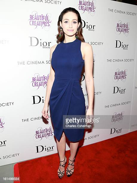 Actress Emmy Rossum arrives at The Cinema Society And Dior Beauty host a screening of 'Beautiful Creatures' at Tribeca Cinemas on February 11 2013 in...
