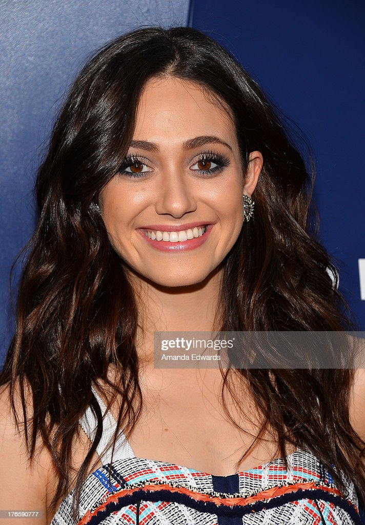 Actress <a gi-track='captionPersonalityLinkClicked' href=/galleries/search?phrase=Emmy+Rossum&family=editorial&specificpeople=202563 ng-click='$event.stopPropagation()'>Emmy Rossum</a> arrives at the Delta Air Lines Summer Celebration at Beverly Grove Drive on August 15, 2013 in Beverly Hills, California.