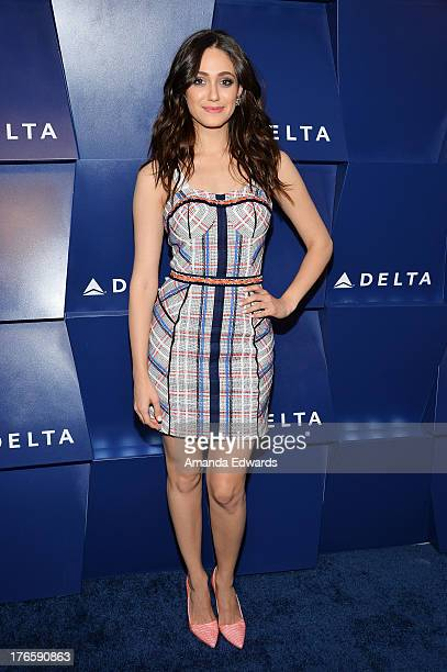 Actress Emmy Rossum arrives at the Delta Air Lines Summer Celebration at Beverly Grove Drive on August 15 2013 in Beverly Hills California