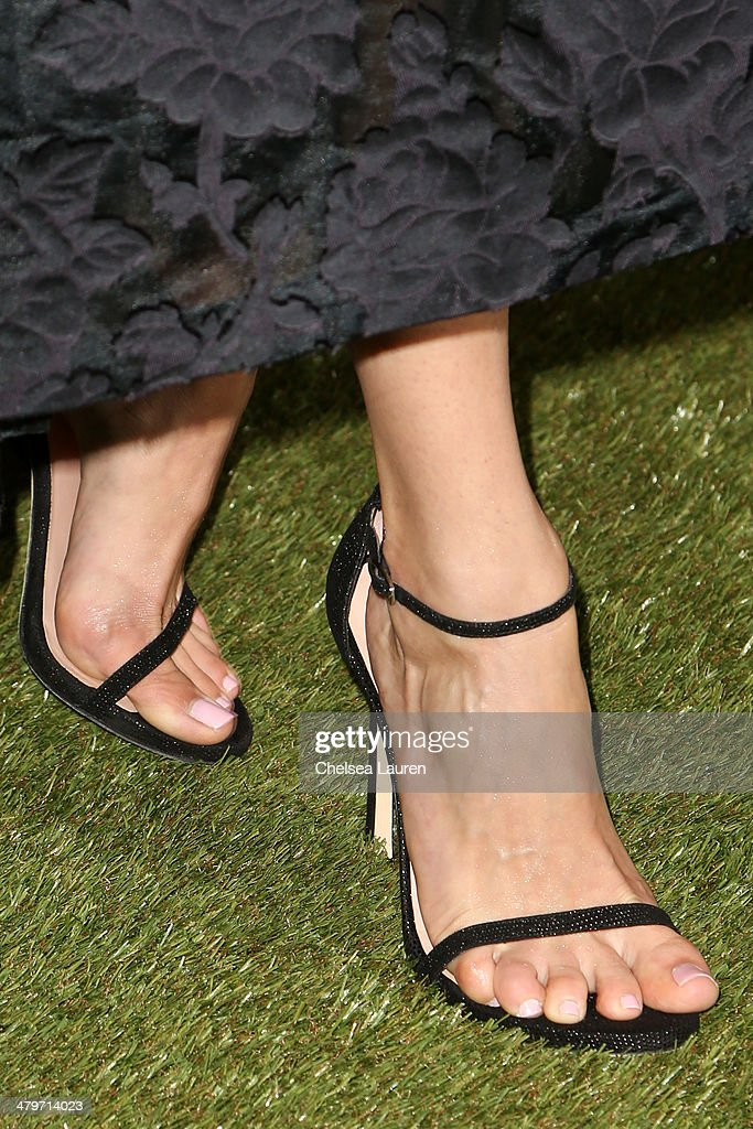 Actress <a gi-track='captionPersonalityLinkClicked' href=/galleries/search?phrase=Emmy+Rossum&family=editorial&specificpeople=202563 ng-click='$event.stopPropagation()'>Emmy Rossum</a> (shoe detail) attends H&M Conscious Exclusive Dinner at Eveleigh on March 19, 2014 in West Hollywood, California.
