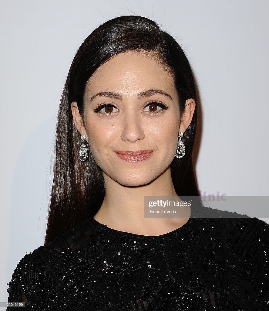 Actress <a gi-track='captionPersonalityLinkClicked' href=/galleries/search?phrase=Emmy+Rossum&family=editorial&specificpeople=202563 ng-click='$event.stopPropagation()'>Emmy Rossum</a> attends Saban Community Clinic's 37th annual benefit gala at The Beverly Hilton Hotel on November 25, 2013 in Beverly Hills, California.