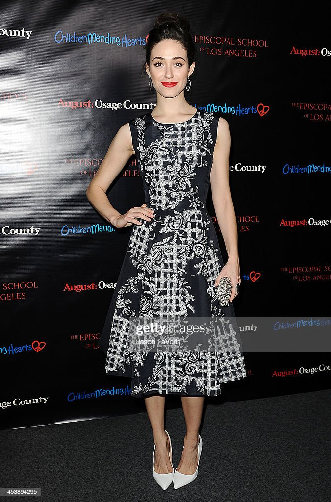 Actress <a gi-track='captionPersonalityLinkClicked' href=/galleries/search?phrase=Emmy+Rossum&family=editorial&specificpeople=202563 ng-click='$event.stopPropagation()'>Emmy Rossum</a> attends the 'August: Osage County' benefit screening at the Landmark Theater on December 5, 2013 in Los Angeles, California.