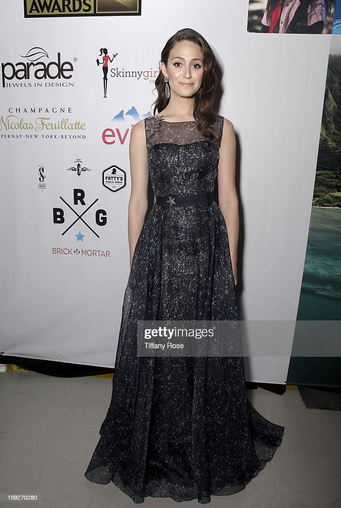 Actress Emmy Rossum attends the Critics' Choice Movie Awards 2013 with Evian at Barker Hangar on January 10, 2013 in Santa Monica, California.