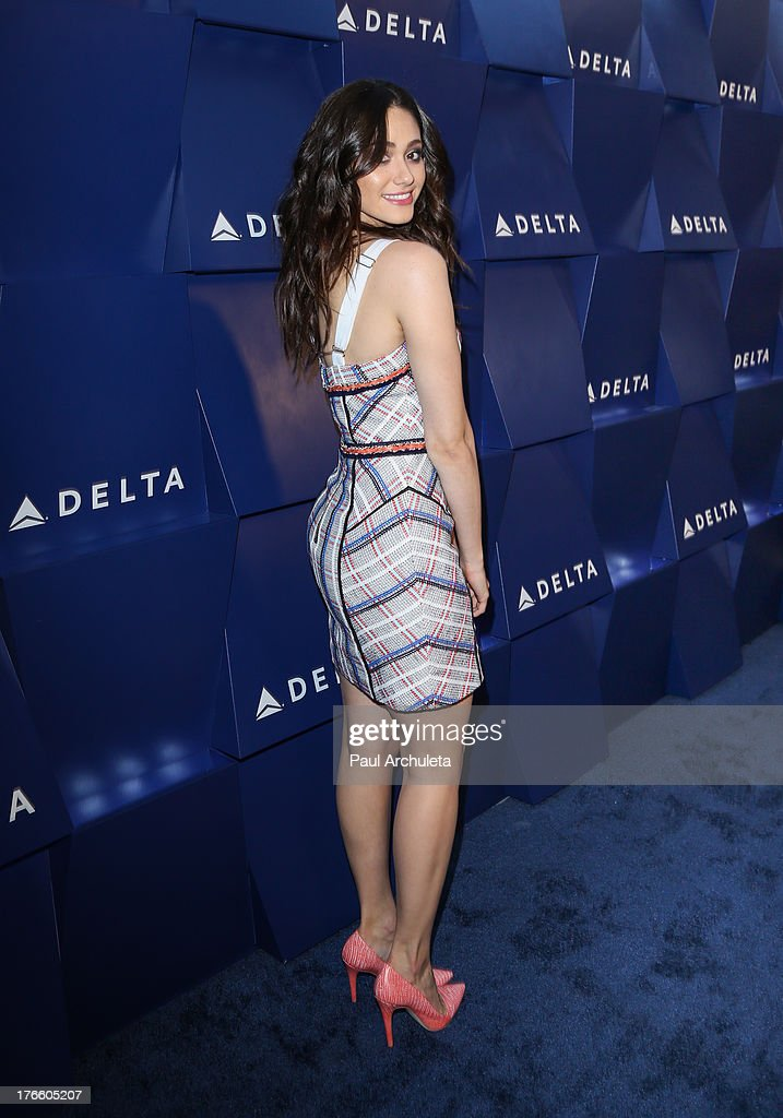 Actress <a gi-track='captionPersonalityLinkClicked' href=/galleries/search?phrase=Emmy+Rossum&family=editorial&specificpeople=202563 ng-click='$event.stopPropagation()'>Emmy Rossum</a> attends the Delta Air Lines summer celebration In Beverly Hills on August 15, 2013 in Beverly Hills, California.