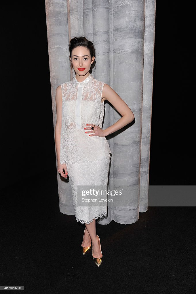 Actress Emmy Rossum attends the Monique Lhuillier fashion show during Mercedes-Benz Fashion Week Fall 2014 at The Theatre at Lincoln Center on February 8, 2014 in New York City.