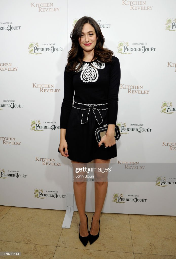 Actress <a gi-track='captionPersonalityLinkClicked' href=/galleries/search?phrase=Emmy+Rossum&family=editorial&specificpeople=202563 ng-click='$event.stopPropagation()'>Emmy Rossum</a> celebrates the release of Ali Larter's new cookbook 'Kitchen Revelry' with Perrier-Jouet at Sunset Tower on August 27, 2013 in West Hollywood, California.