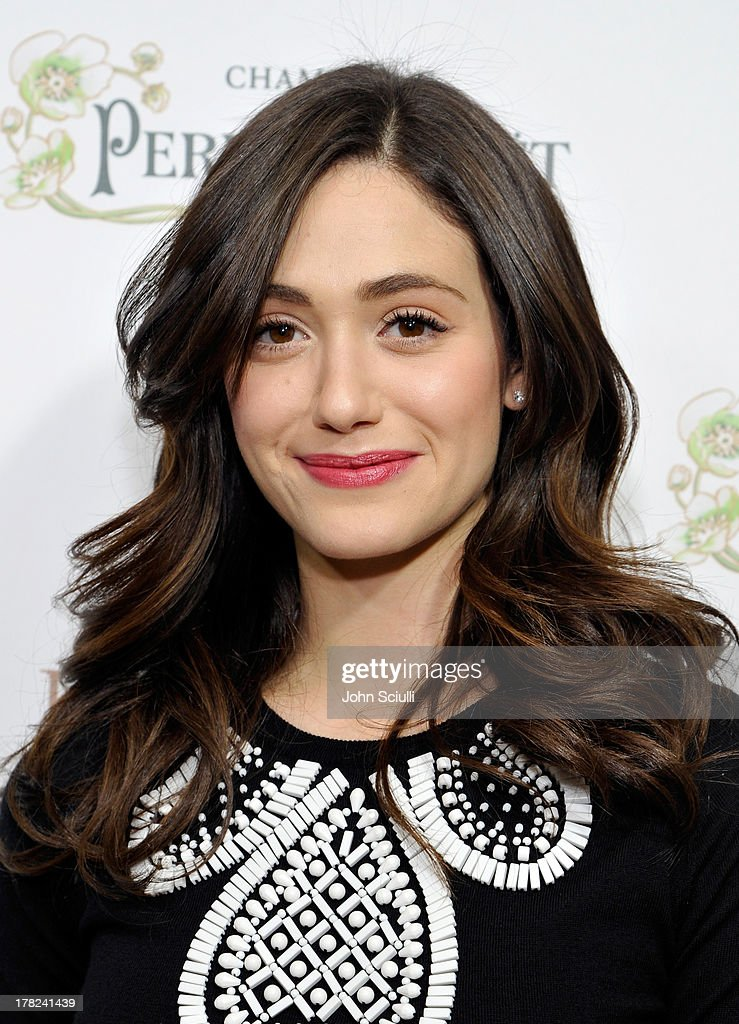 Actress Emmy Rossum celebrates the release of Ali Larter's new cookbook 'Kitchen Revelry' with Perrier-Jouet at Sunset Tower on August 27, 2013 in West Hollywood, California.