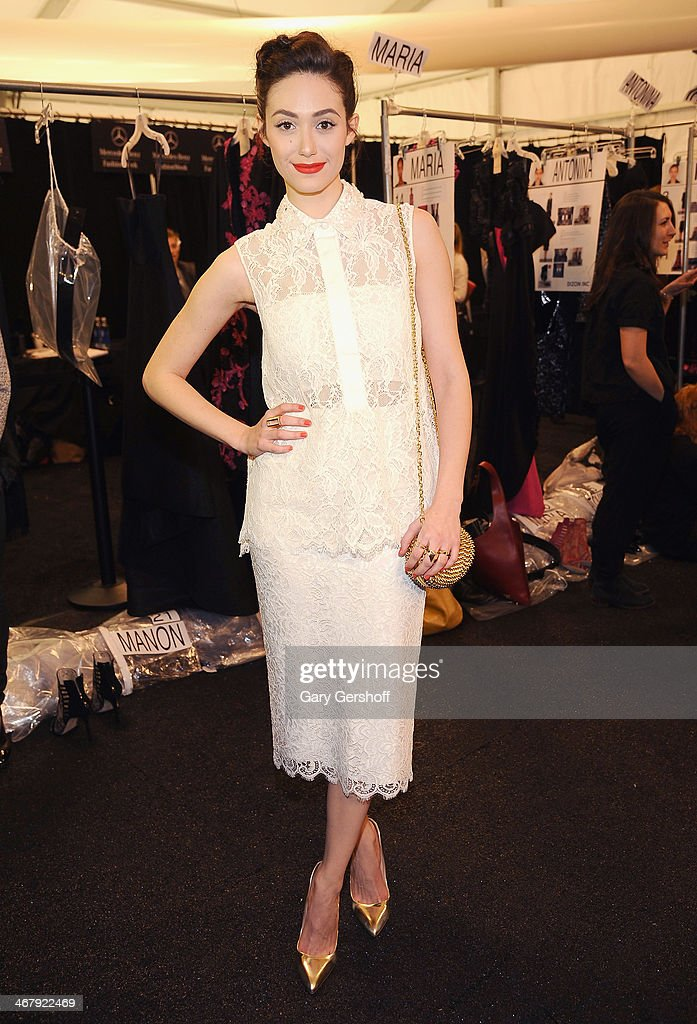 Actress Emmy Rossum poses backstage at the Monique Lhuillier show during Mercedes-Benz Fashion Week Fall 2014 at The Theatre at Lincoln Center on February 8, 2014 in New York City.