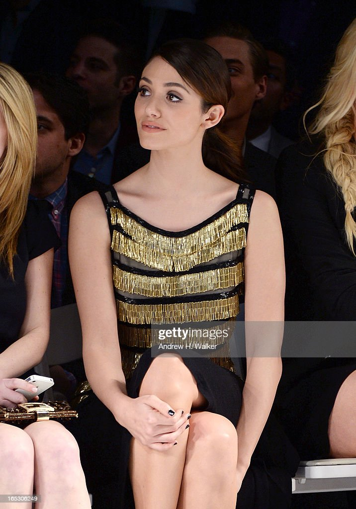 Actress Emmy Rossum watches a fashion show at the Jeffrey Fashion Cares 10th Anniversary Celebration at The Intrepid on April 2, 2013 in New York City.