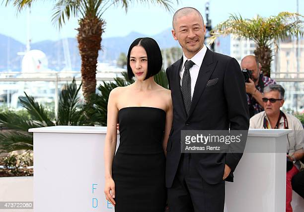 Actress Eri Fukatsu and actor Tadanobu Asano attend a photocall for 'Kishibe No Tabi' during the 68th annual Cannes Film Festival on May 17 2015 in...