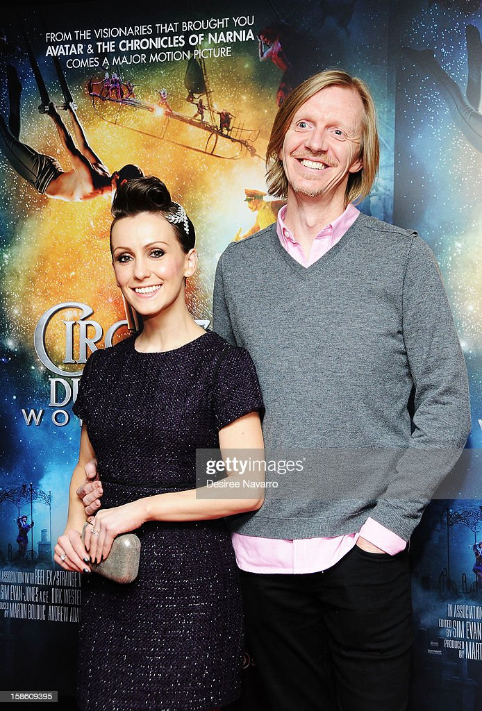 Actress Erica Linz and Director <a gi-track='captionPersonalityLinkClicked' href=/galleries/search?phrase=Andrew+Adamson&family=editorial&specificpeople=770048 ng-click='$event.stopPropagation()'>Andrew Adamson</a> (R) attend 'Cirque Du Soleil: Worlds Away' New York Screening at Regal E-Walk on December 20, 2012 in New York City.