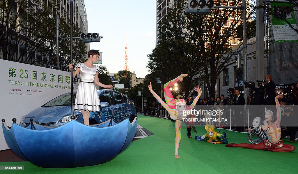 Actress Erica Linz (L) in Tokyo International Film Festival (TIFF) opening movie, 'Cirque du soleil: Worlds Away' performs with Cirque du soleil artists during the festival's opening ceremony in Tokyo on October 20, 2012. With China's main entry to the film festival being pulled, a total of 103 movies will be screened during the nine-day event.