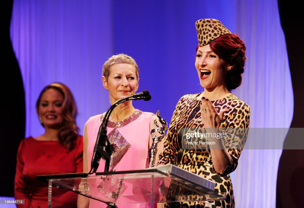 Actress Erika Christensen presents costume designers Lou Eyrich and Jennifer Eve with the award for Outstanding Contemporary Television Series onstage during the 14th Annual Costume Designers Guild Awards With Presenting Sponsor Lacoste held at The Beverly Hilton hotel on February 21, 2012 in Beverly Hills, California.