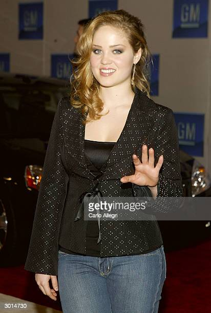 Actress Erika Christiansen gestures as she arrives for the 3rd Annual 'ten' fashion show and charity event to celebrate awards season and car culture...