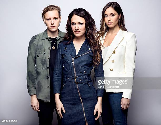 Actress Erika Linder director April Mullen and actress Natalie Krill from the film Below Her Mouth pose for a portraits at the Toronto International...