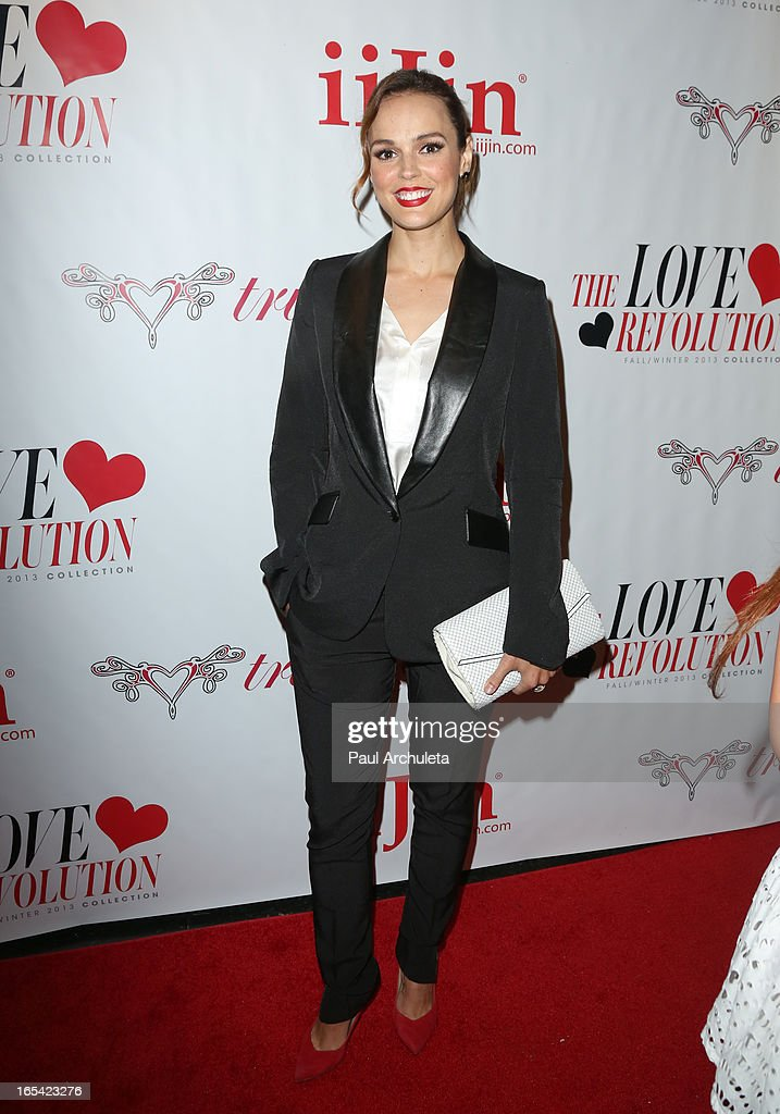 Actress <a gi-track='captionPersonalityLinkClicked' href=/galleries/search?phrase=Erin+Cahill&family=editorial&specificpeople=640206 ng-click='$event.stopPropagation()'>Erin Cahill</a> attends iiJin's Fall/Winter 2013 'The Love Revolution' fashion show at Avalon on April 3, 2013 in Hollywood, California.