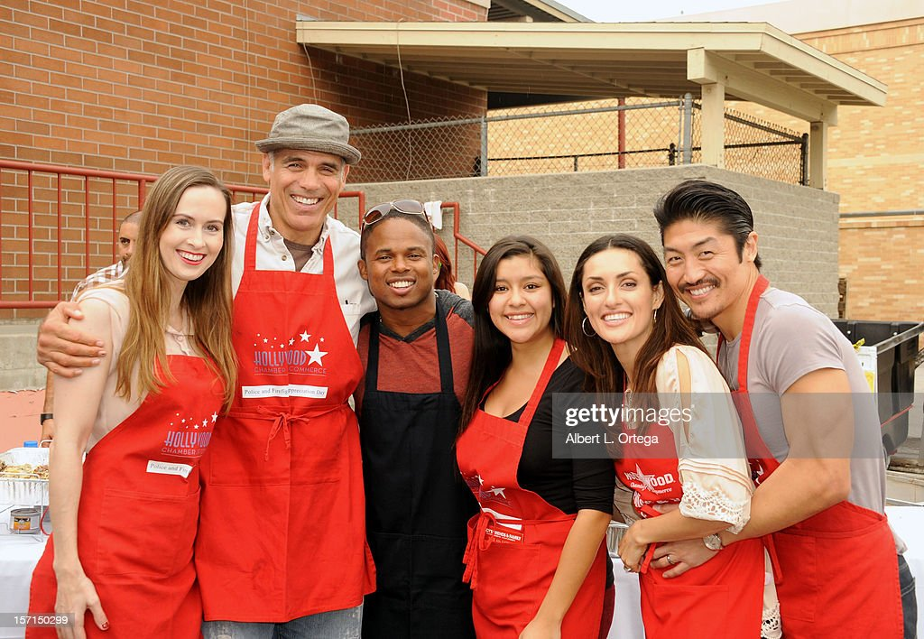 Actress Erin Carufel, actor Greg Collins, actor Walter Jones, actress Chelsea Rendon, actress Mirelly Taylor and Brian Tee participate in the Hollywood Chamber of Commerce's annual police and firefighters appreciation day at the Hollywood LAPD station on November 28, 2012 in Hollywood, California.