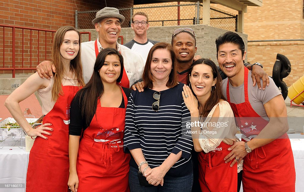 Actress Erin Carufel, actor Greg Collins, actress Chelsea Rendon, chef C.J. Jacobsen, Hollywood Chamber of Commerce's Ana Martinez, actor <a gi-track='captionPersonalityLinkClicked' href=/galleries/search?phrase=Walter+Jones+-+Ator&family=editorial&specificpeople=15209956 ng-click='$event.stopPropagation()'>Walter Jones</a>, actress Mirelly Taylor and actor <a gi-track='captionPersonalityLinkClicked' href=/galleries/search?phrase=Brian+Tee&family=editorial&specificpeople=593958 ng-click='$event.stopPropagation()'>Brian Tee</a> participate in the Hollywood Chamber of Commerce's annual police and firefighters appreciation day at the Hollywood LAPD station on November 28, 2012 in Hollywood, California.