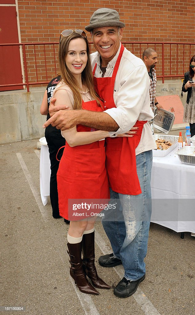 Actress Erin Carufel and actor Greg Collins participate in the Hollywood Chamber of Commerce's annual police and firefighters appreciation day at the Hollywood LAPD station on November 28, 2012 in Hollywood, California.