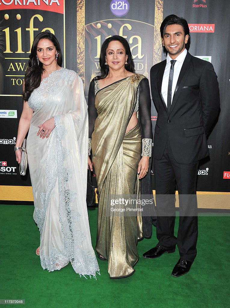 Actress Esha Deol, <a gi-track='captionPersonalityLinkClicked' href=/galleries/search?phrase=Hema+Malini&family=editorial&specificpeople=1026787 ng-click='$event.stopPropagation()'>Hema Malini</a> and Ranbir Singh attend the MAC Cosmetics Sponsored IIFAS Awards Presentation at the Rogers Centre on June 25, 2011 in Toronto, Canada.