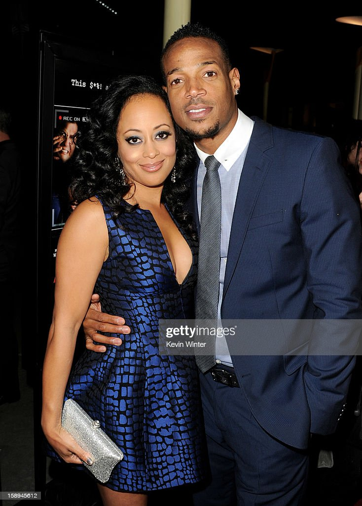 Actress Essence Atkins (L) and co-writer/producer/actor Marlon Wayans arrive at the premiere of Open Road Films' 'A Haunted House' at the Arclight Theatre on January 3, 2013 in Los Angeles, California.