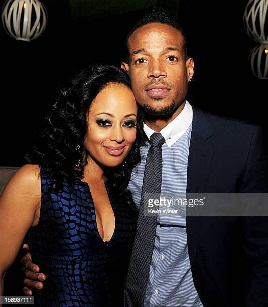 Actress Essence Atkins and cowriter/producer/actor Marlon Wayans pose at the after party for the premiere of Open Roads Films' 'A Haunted House' at...