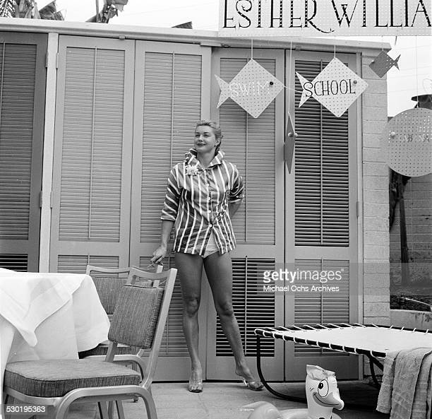 Actress Esther Williams poses by her Esther Williams Swim School sign during the opening day of the Esther Williams Swim School at the Hilton Hotel...