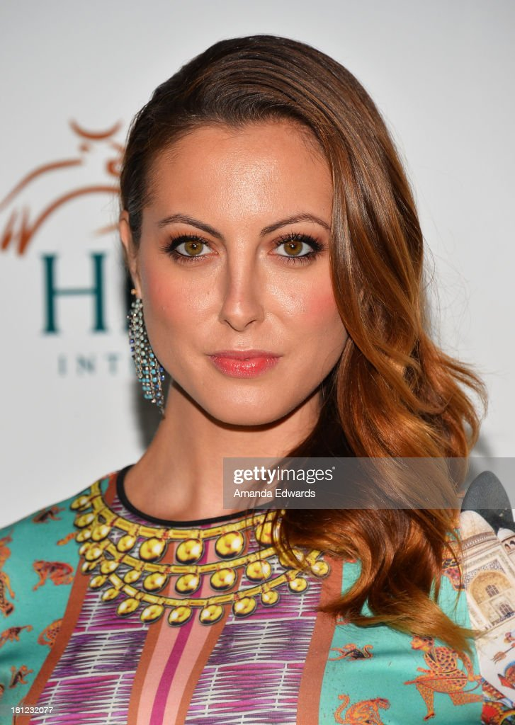 Actress <a gi-track='captionPersonalityLinkClicked' href=/galleries/search?phrase=Eva+Amurri&family=editorial&specificpeople=213733 ng-click='$event.stopPropagation()'>Eva Amurri</a> Martino arrives at the 2nd Annual Beyond Hunger: A Place At The Table Benefit Honoring Susan Sarandon at Montage Beverly Hills on September 19, 2013 in Beverly Hills, California.