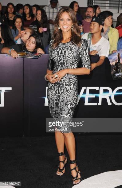 Actress Eva LaRue arrives at the Los Angeles Premiere 'Divergent' at Regency Bruin Theatre on March 18 2014 in Los Angeles California