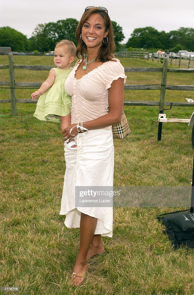 Actress Eva LaRue Callahan poses with her daughter, Kaya, at the 5th Annual Super Saturday Designer Sale to benefit the Ovarian Cancer Research Fund on July 27, 2002 at Nova's Ark in Watermill, New York.