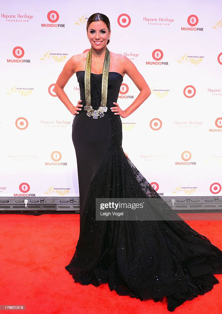 Actress <a gi-track='captionPersonalityLinkClicked' href=/galleries/search?phrase=Eva+Longoria&family=editorial&specificpeople=202082 ng-click='$event.stopPropagation()'>Eva Longoria</a> accepts the Community Service Award at the 26th Annual Hispanic Heritage Awards presented by Target at the John F. Kennedy Center for the Performing Arts on September 5, 2013 in Washington, DC.