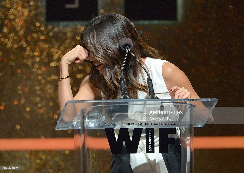 Actress <a gi-track='captionPersonalityLinkClicked' href=/galleries/search?phrase=Eva+Longoria&family=editorial&specificpeople=202082 ng-click='$event.stopPropagation()'>Eva Longoria</a> accepts the Norma Zarky Humanitarian Award onstage at Women In Film 2014 Crystal + Lucy Awards presented by MaxMara, BMW, Perrier-Jouet and South Coast Plaza held at the Hyatt Regency Century Plaza on June 11, 2014 in Los Angeles, California.