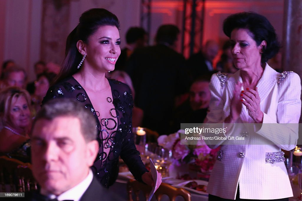 Actress Eva Longoria (L) and Debra Mace attend the 'Global Gift Gala' 2013 dinner and auction presented by Eva Longoria at Carlton Hotel on May 19, 2013 in Cannes, France.