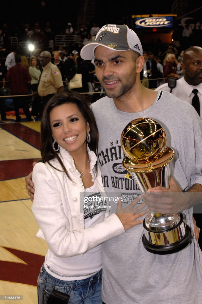 Actress Eva Longoria and her financee Finals MVP Tony Parker #9 of the San Antonio Spurs after the Spurs won the NBA Championship with their 83-82 win against the Cleveland Cavaliers in Game Four of the NBA Finals at the Quicken Loans Arena on June 14, 2007 in Cleveland, Ohio.