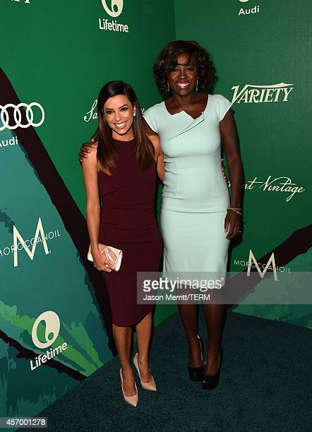 Actress Eva Longoria and honoree Viola Davis attend the 2014 Variety Power of Women presented by Lifetime at Beverly Wilshire Four Seasons on October...