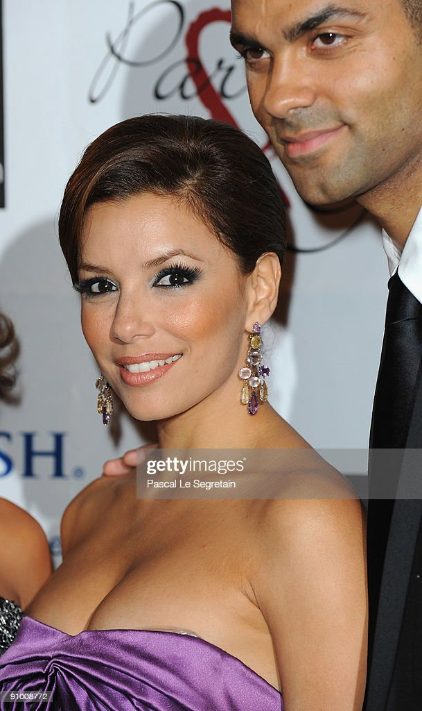 Actress <a gi-track='captionPersonalityLinkClicked' href=/galleries/search?phrase=Eva+Longoria&family=editorial&specificpeople=202082 ng-click='$event.stopPropagation()'>Eva Longoria</a> and <a gi-track='captionPersonalityLinkClicked' href=/galleries/search?phrase=Tony+Parker&family=editorial&specificpeople=160952 ng-click='$event.stopPropagation()'>Tony Parker</a> pose as they arrive to attend the 'Par Coeur Gala' dinner at the Hotel Meurice on September 21, 2009 in Paris, France.