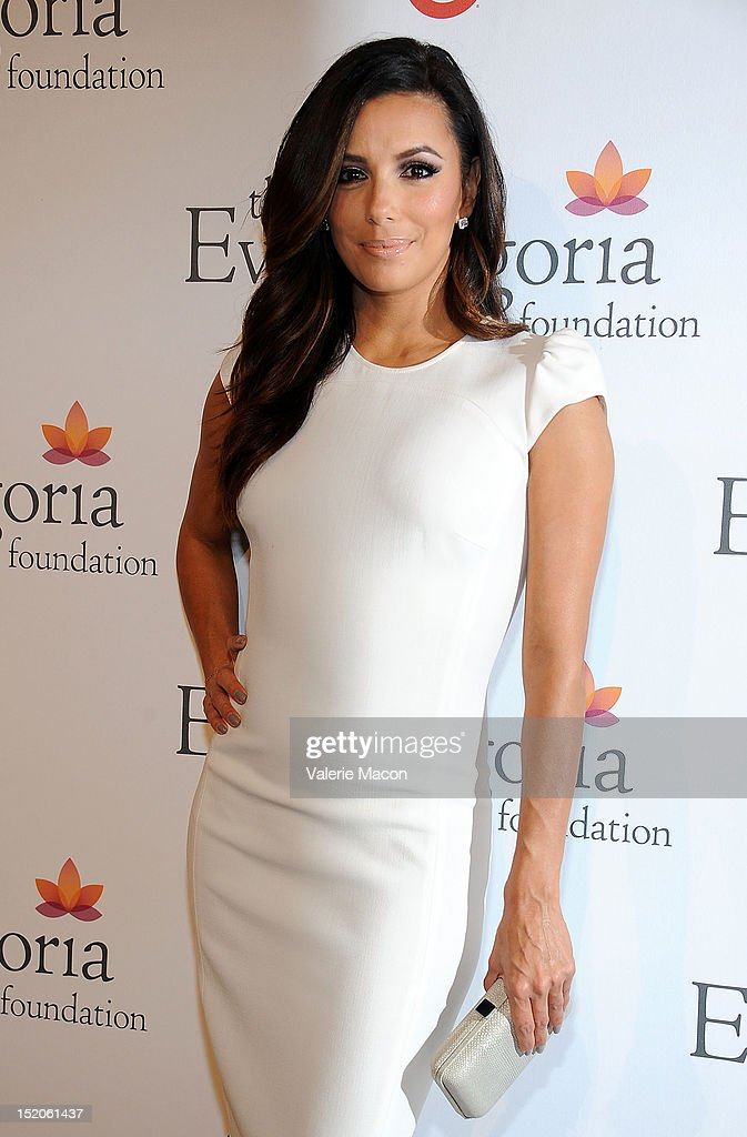 Actress <a gi-track='captionPersonalityLinkClicked' href=/galleries/search?phrase=Eva+Longoria&family=editorial&specificpeople=202082 ng-click='$event.stopPropagation()'>Eva Longoria</a> arrives at The <a gi-track='captionPersonalityLinkClicked' href=/galleries/search?phrase=Eva+Longoria&family=editorial&specificpeople=202082 ng-click='$event.stopPropagation()'>Eva Longoria</a> Foundation's Pre-ALMA Awards Dinner Presented By Target on September 15, 2012 in Los Angeles, California.